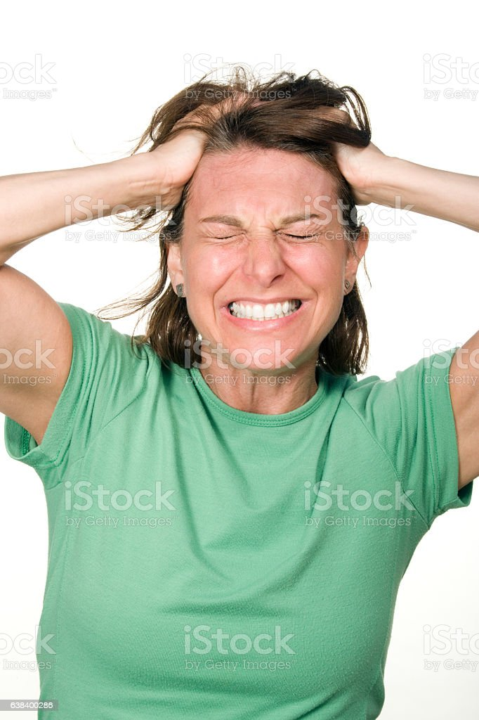 Mature woman making angry expression on white background stock photo