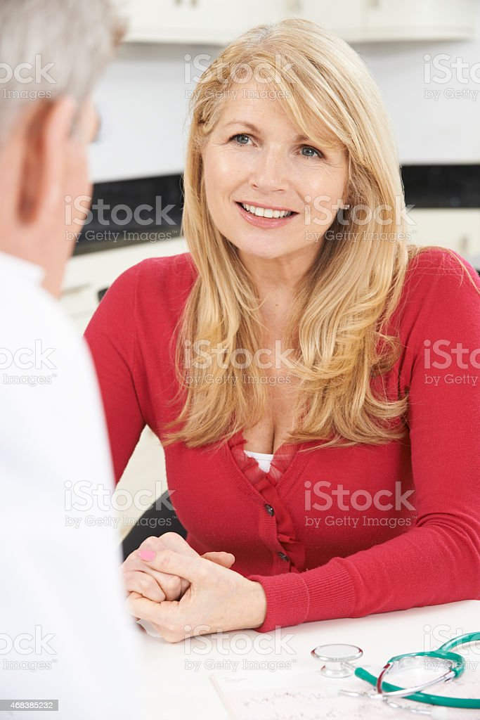 Mature Woman Meeting With Doctor In Surgery stock photo