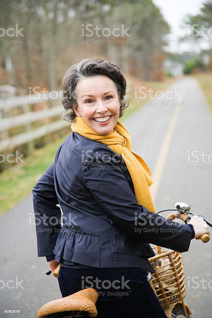 Mature woman on a bicycle royalty-free stock photo