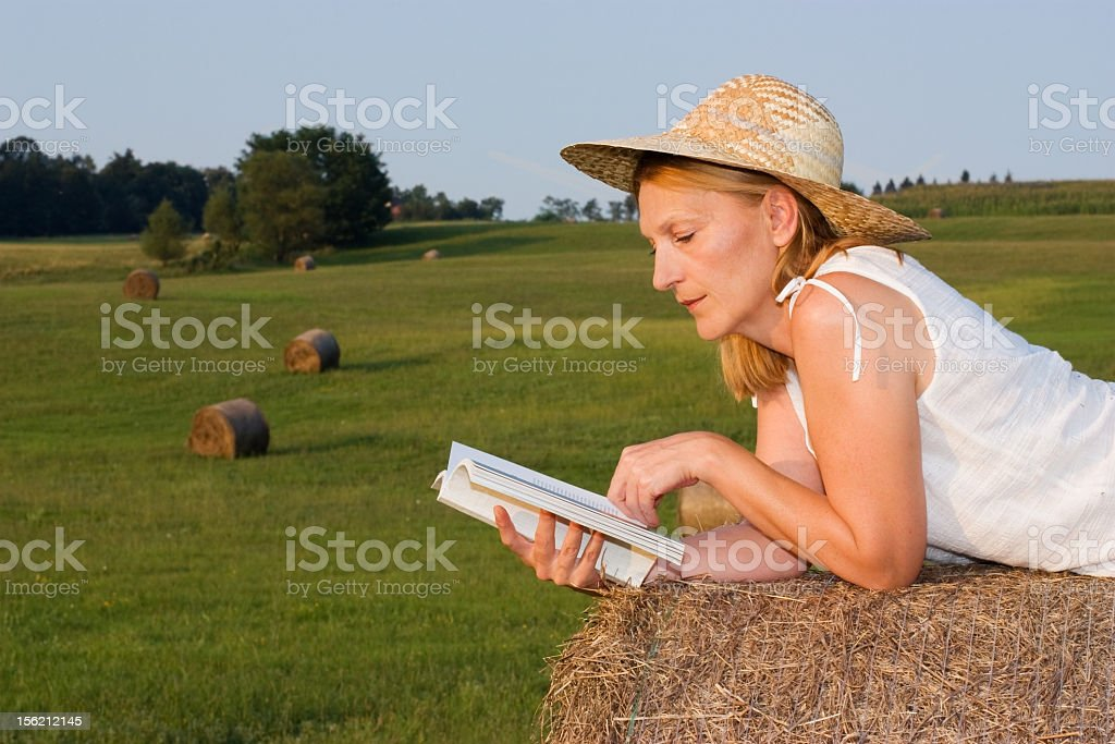 Mature Woman on a haystack royalty-free stock photo