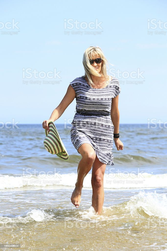 mature woman on beach summer holiday royalty-free stock photo