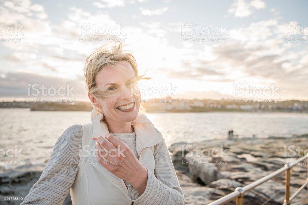 Mature woman on vacation smiling to camera, Bondi Beach stock photo