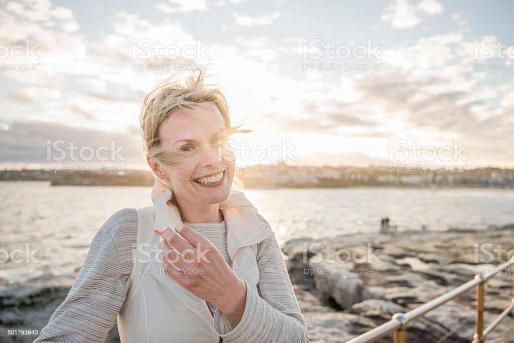 Mature woman on vacation smiling to camera, Bondi Beach stock photo