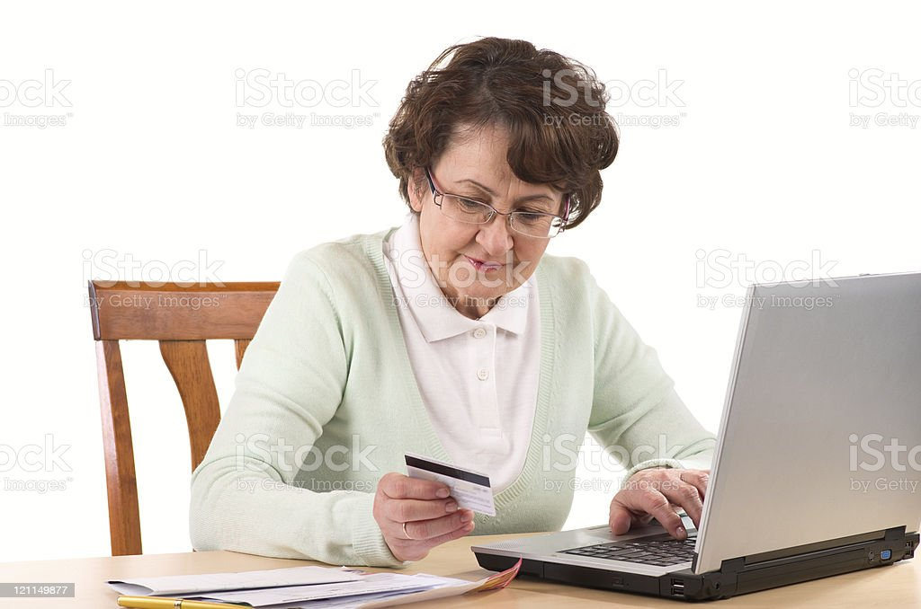 mature woman online banking royalty-free stock photo