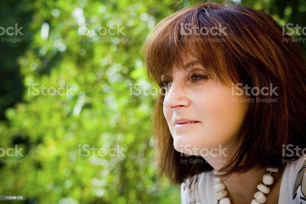 mature woman optimistic thoughtful royalty-free stock photo