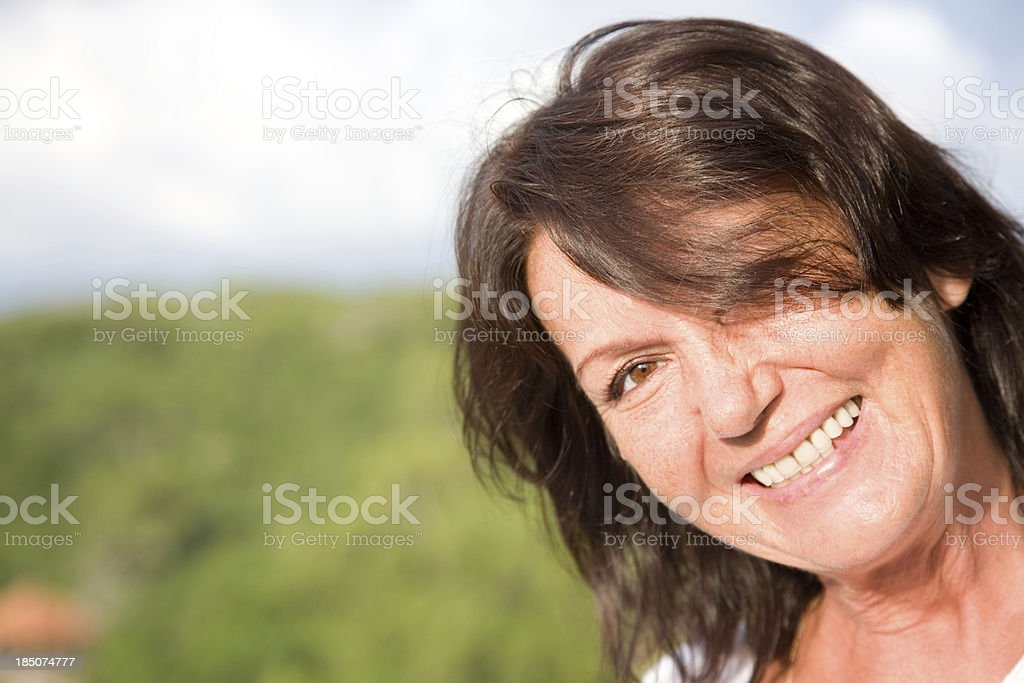 Mature woman outdoors royalty-free stock photo