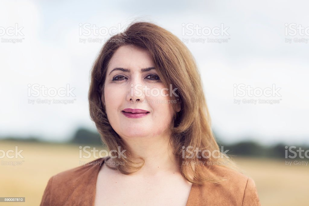 Mature woman outdoors porrait stock photo