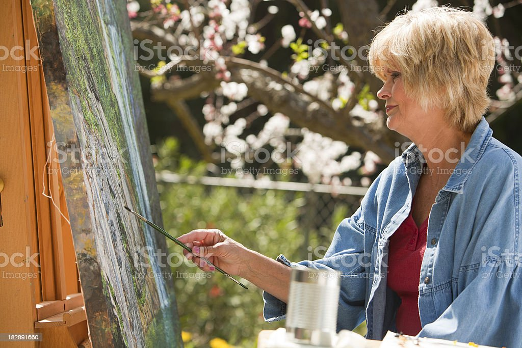 Mature Woman Painting royalty-free stock photo
