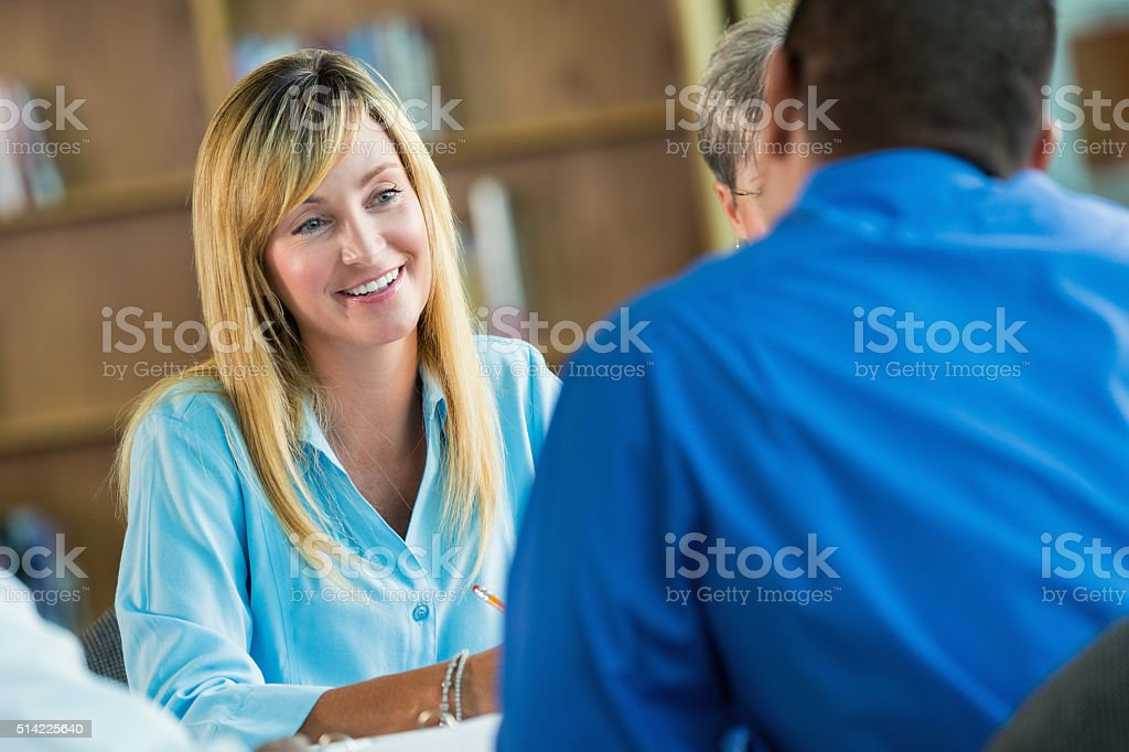 Mature Woman participates in discussion group stock photo