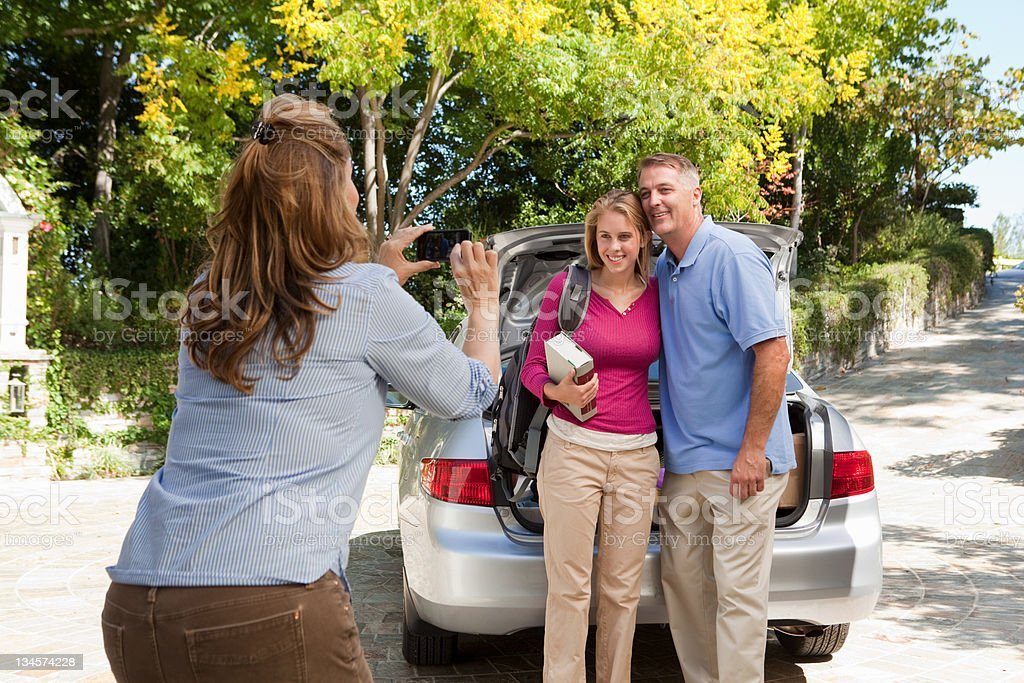 Mature woman photographing family stock photo