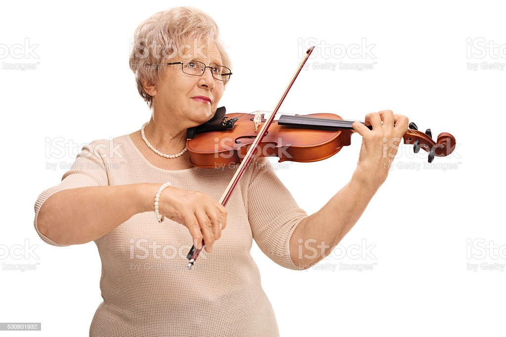 Mature woman playing acoustic violin stock photo