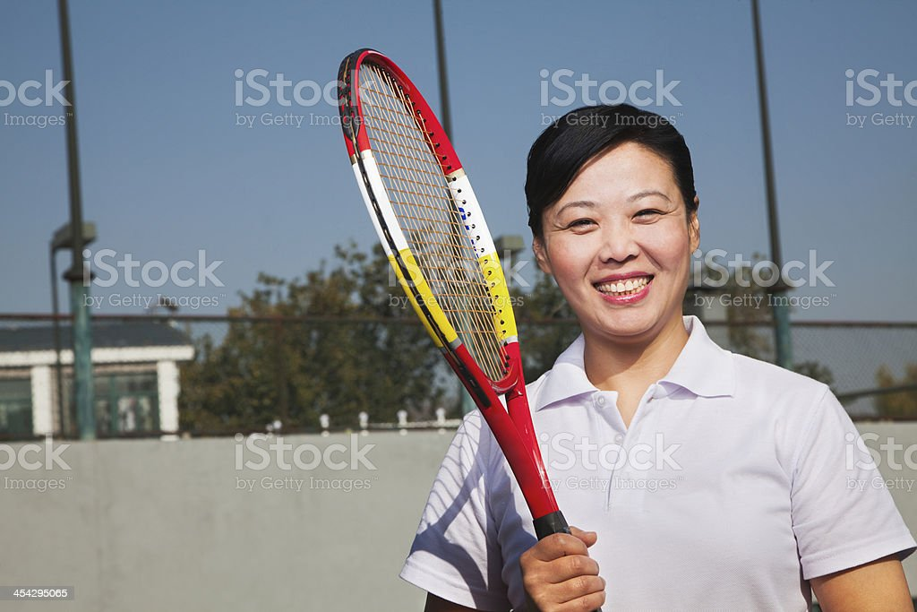Mature woman playing tennis, portrait royalty-free stock photo
