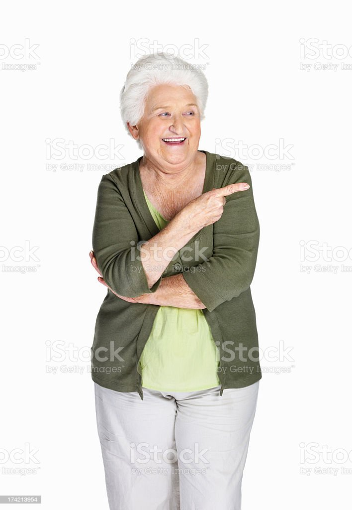 Mature woman pointing at something interesting against white stock photo