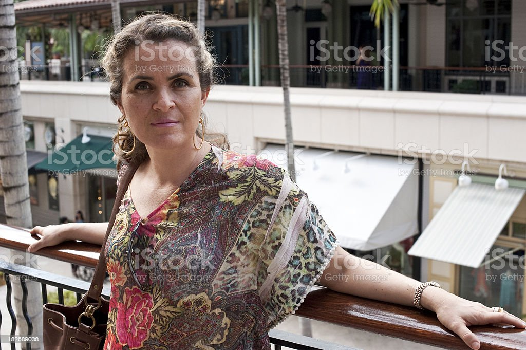 Mature woman posing at a shopping mall stock photo