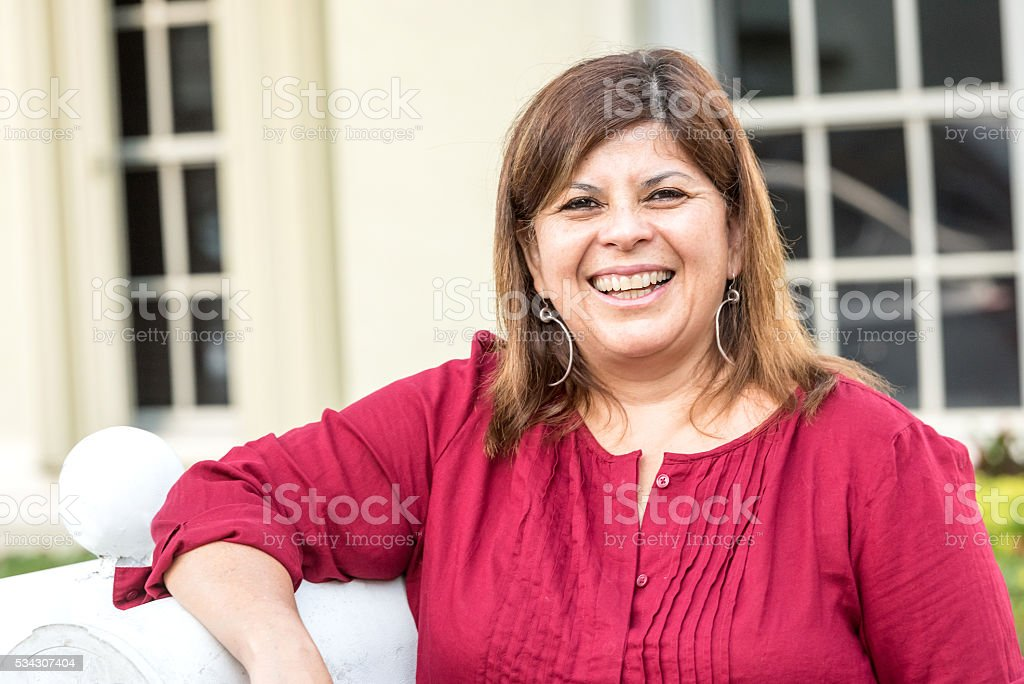 Mature woman posing at her home frontyard stock photo