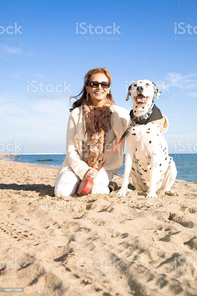 Mature woman posing with dalmatian dog stock photo