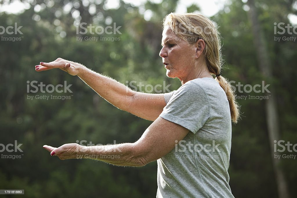 Mature woman practicing tai chi stock photo