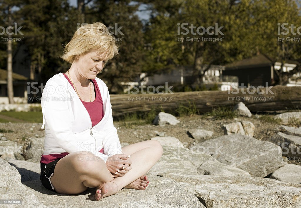 Mature Woman Praying by the Beach royalty-free stock photo