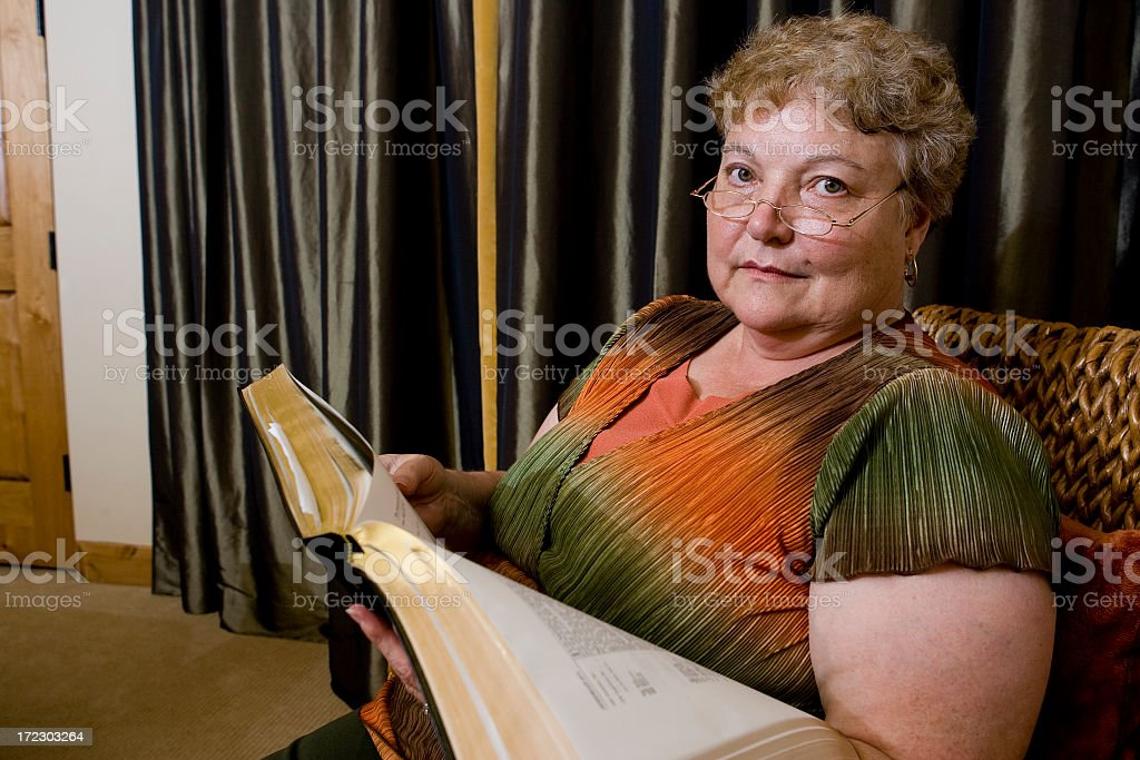 Mature Woman Reading stock photo