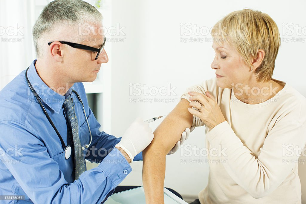 Mature Woman Receiving Vaccine royalty-free stock photo