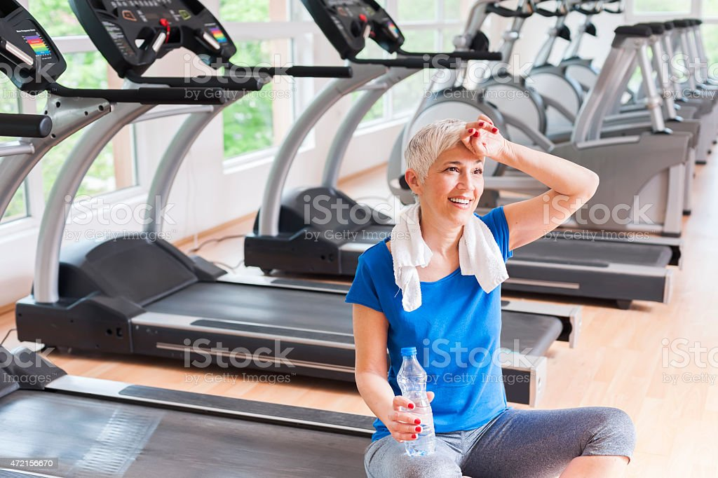 Mature woman relaxing after exercise stock photo