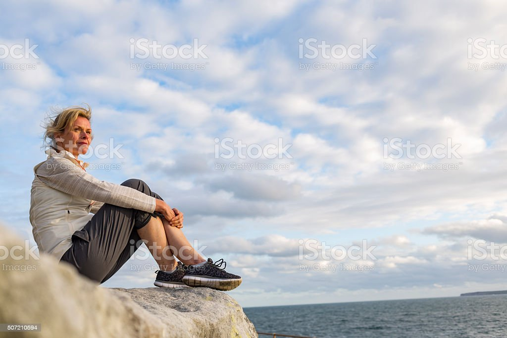 Mature Woman Relaxing After Hiking by the Sydney Seaside Australia stock photo