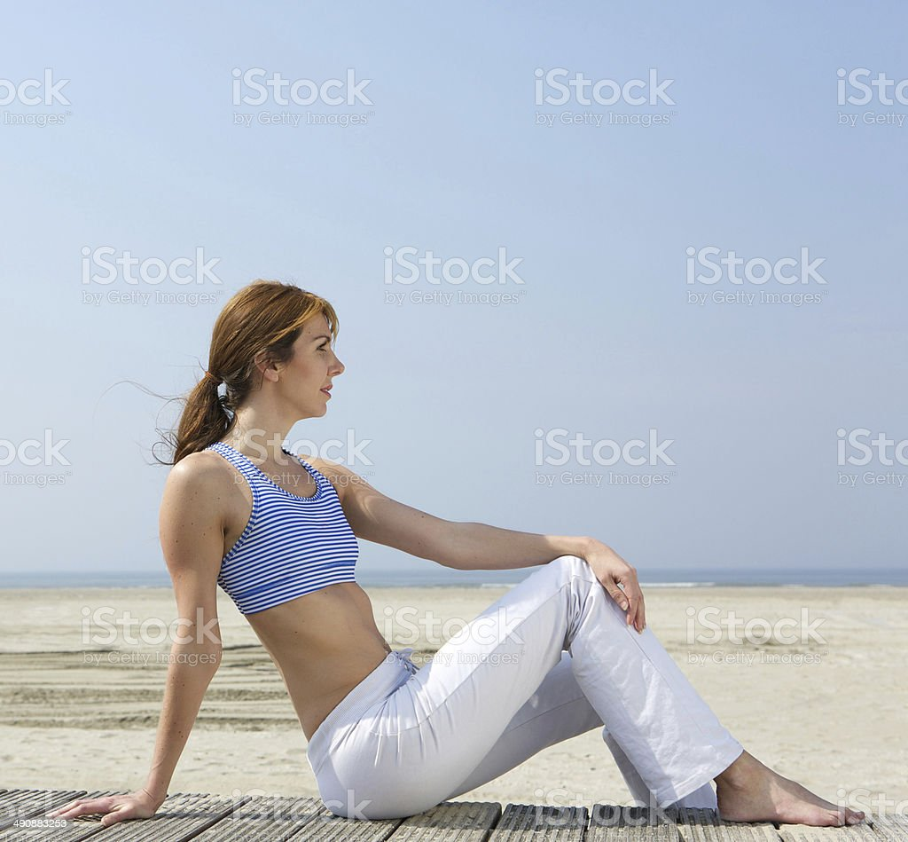 Mature woman relaxing at the beach royalty-free stock photo