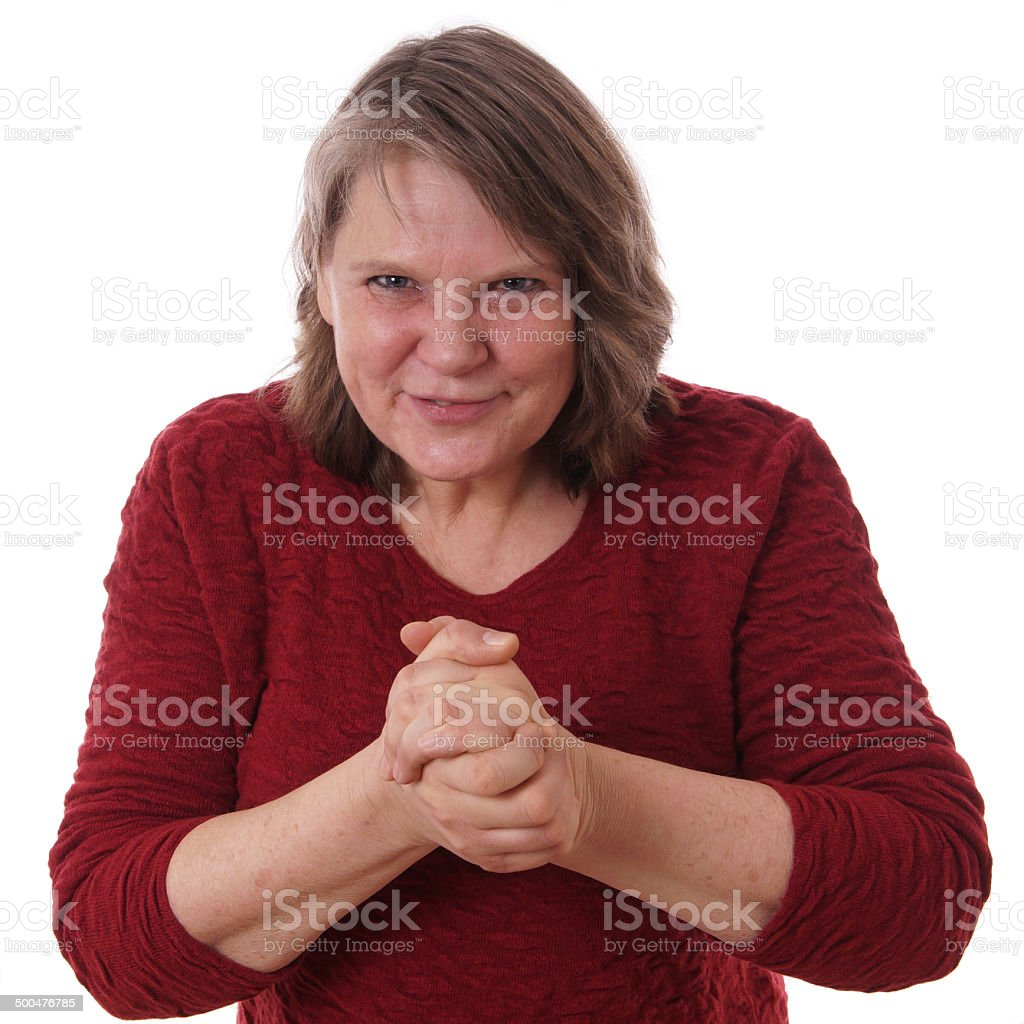 mature woman rubbing hands royalty-free stock photo