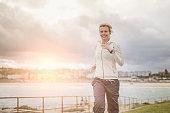 Mature woman running in Bondi beach