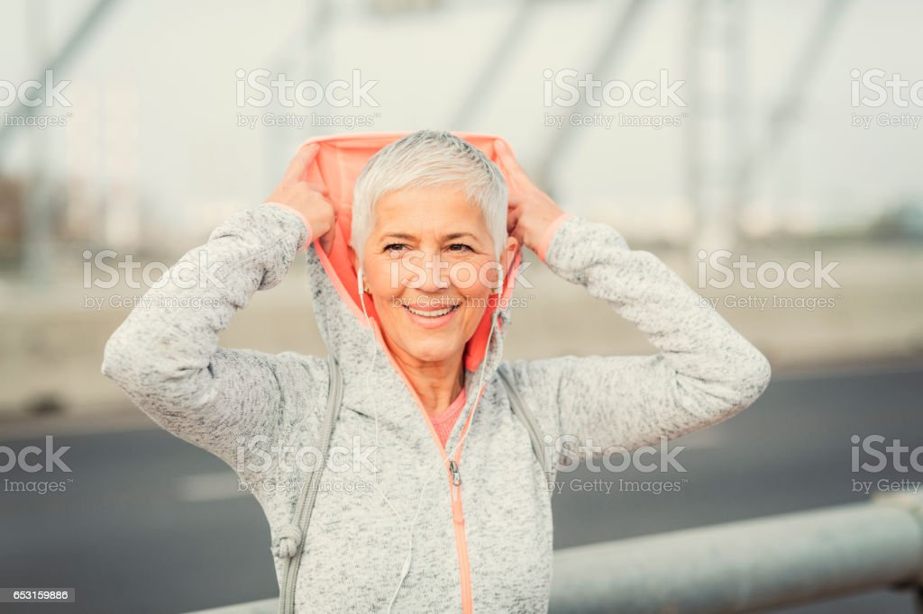 Mature Woman Running In The City stock photo