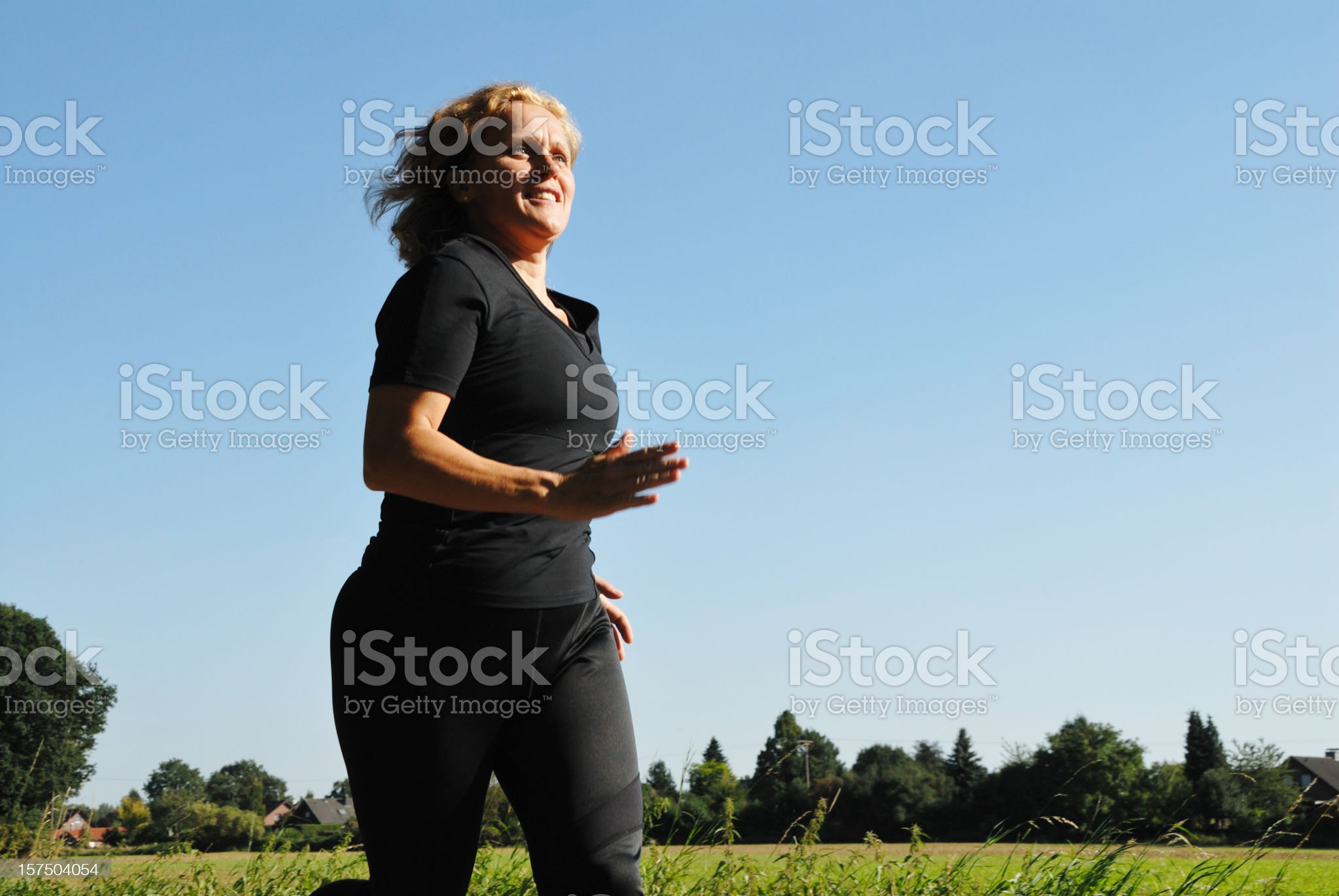 mature woman running royalty-free stock photo