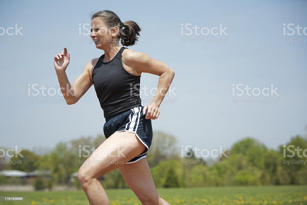 mature woman running royalty-free stock photo