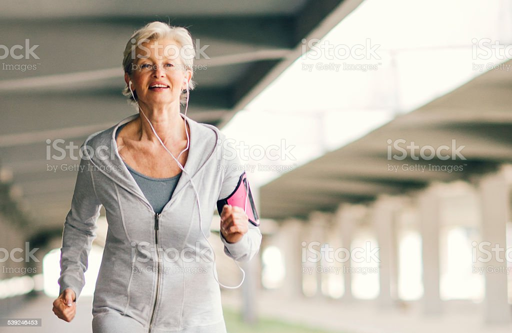 Mature Woman Running. stock photo