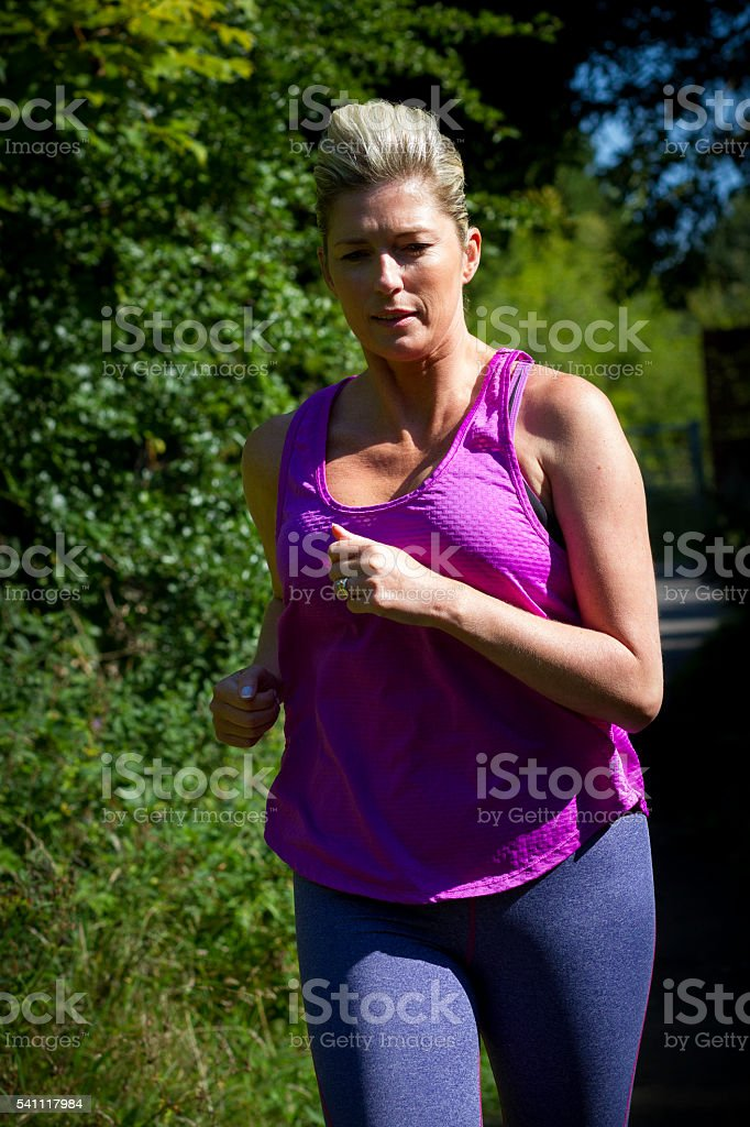 Mature Woman Running stock photo