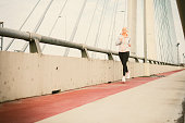 Mature Woman Running The City