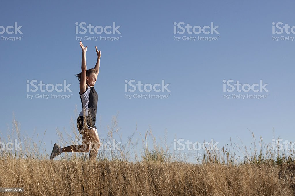 Mature Woman Running to Victory Outdoors royalty-free stock photo