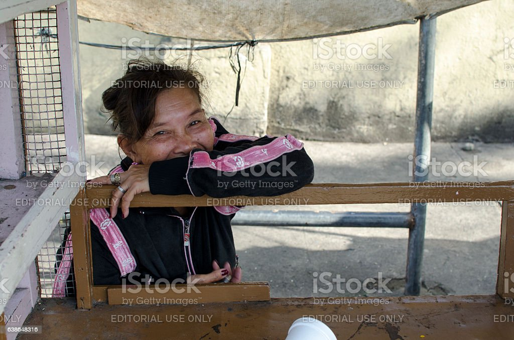 Mature woman Schizophrenic seated on cart laughing stock photo