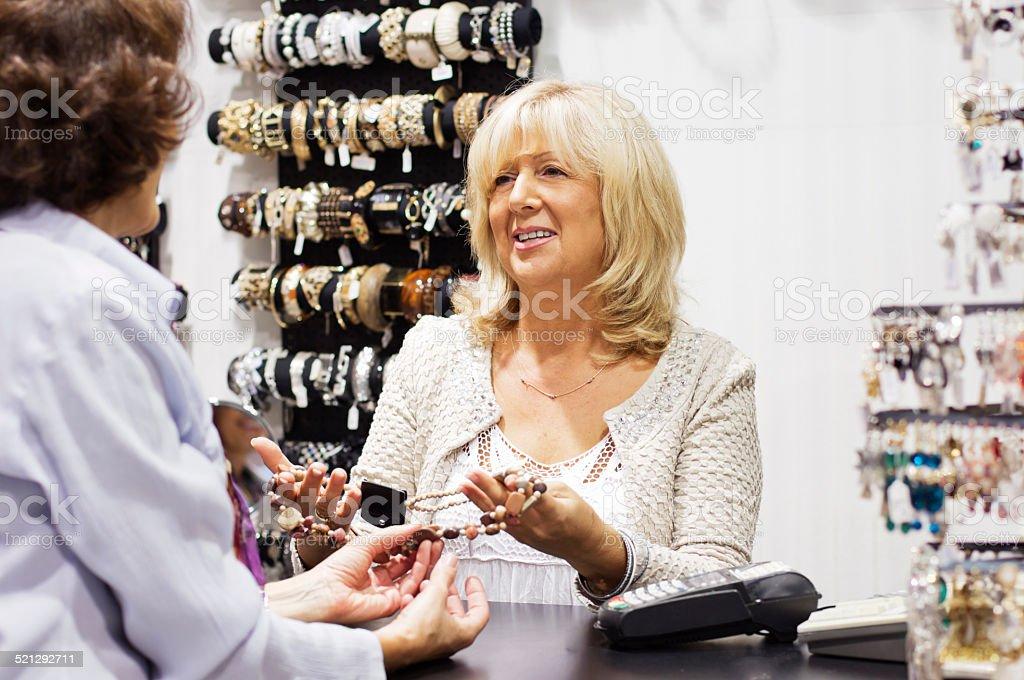 Mature woman seller stock photo