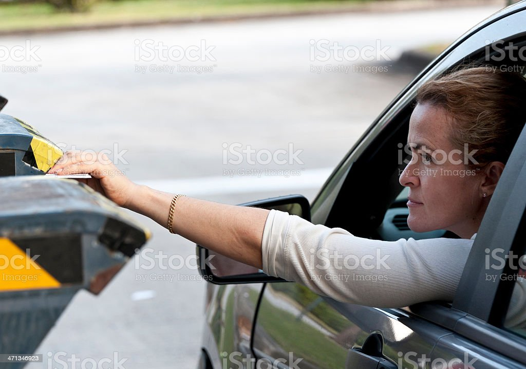 Mature woman sending the mail stock photo