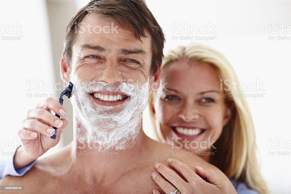 Mature woman shaving her husband stock photo