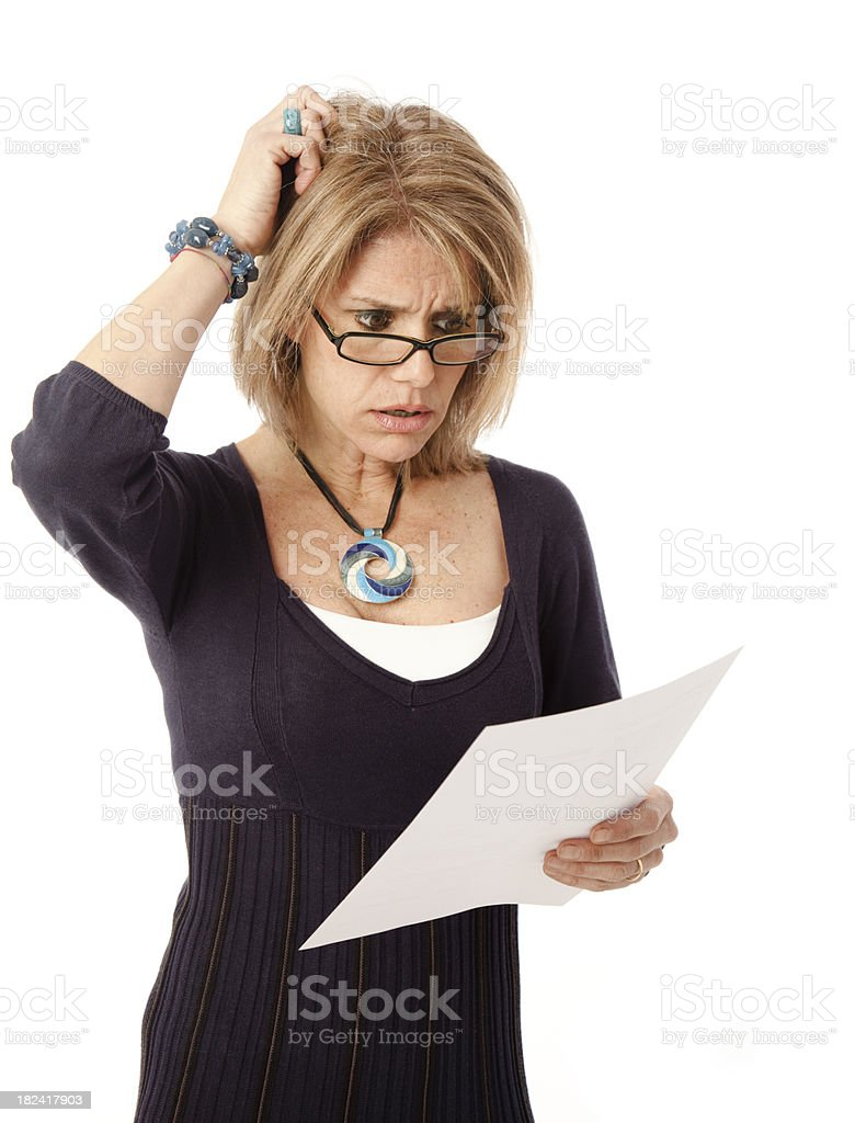Mature woman shocked by bill or communication royalty-free stock photo