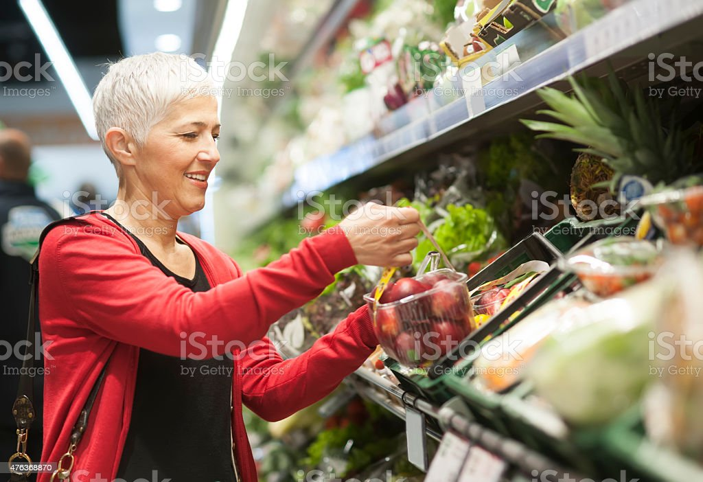 Mature woman shopping at market stock photo
