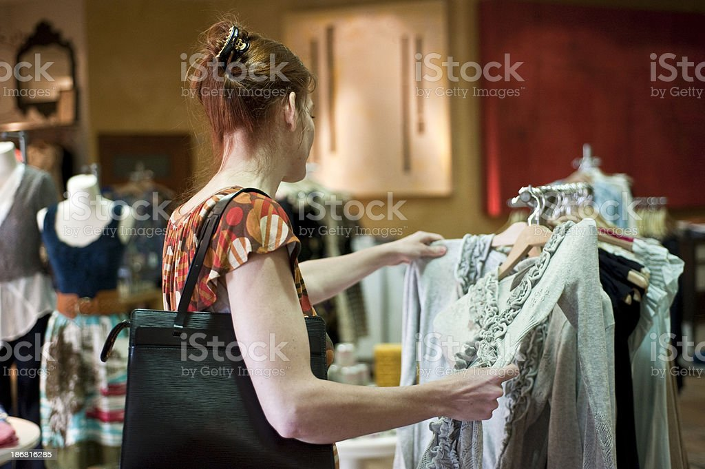 Mature woman shopping for a dress royalty-free stock photo