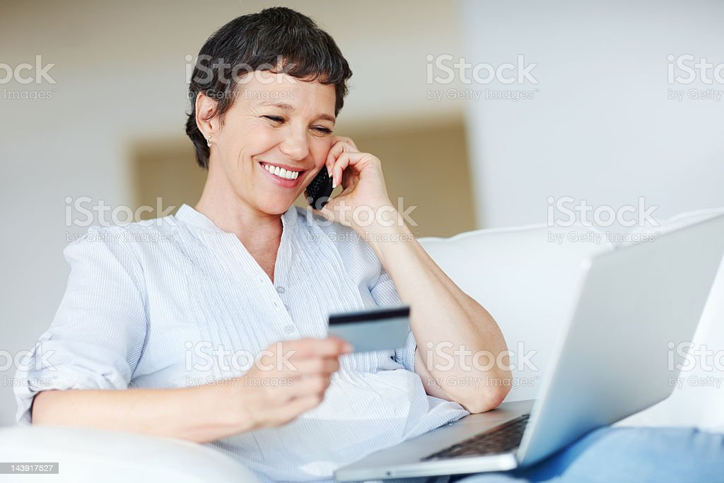 Mature woman shopping online royalty-free stock photo