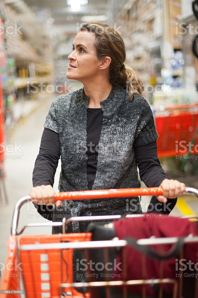 Mature woman shopping stock photo