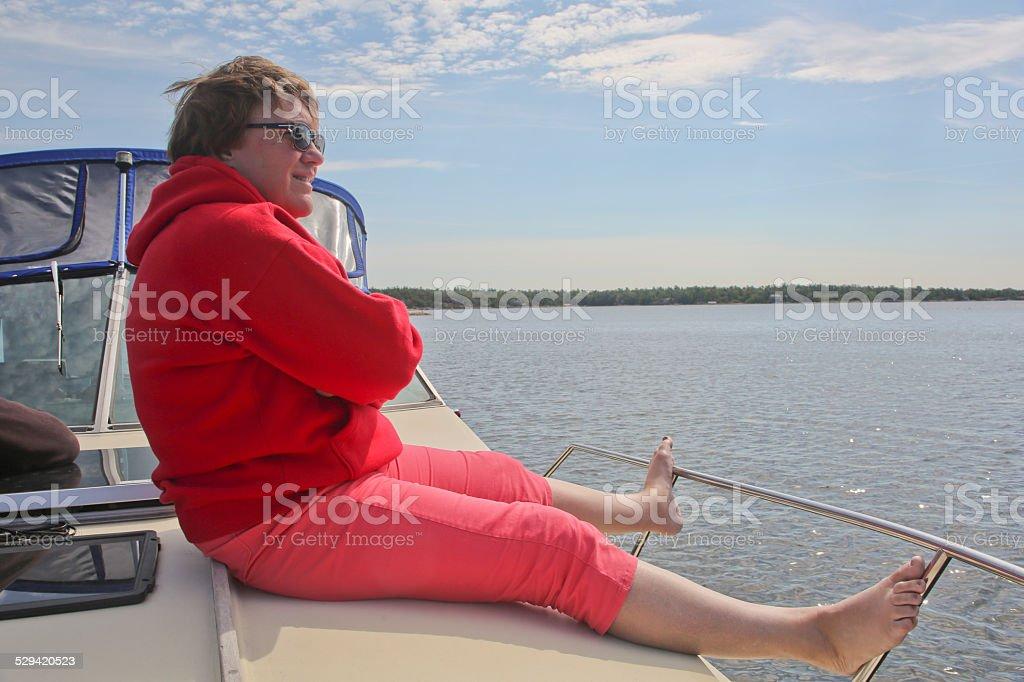 Mature Woman Sitting on Yacht Deck, Georgian Bay stock photo