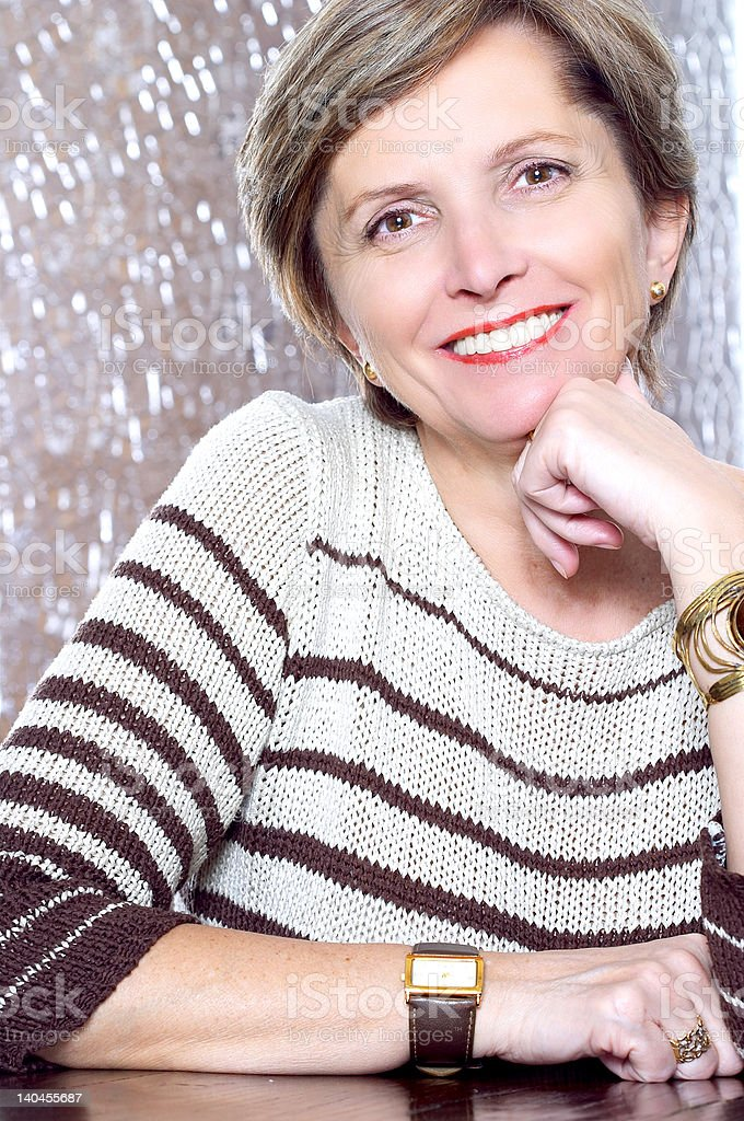 Mature woman smiles royalty-free stock photo