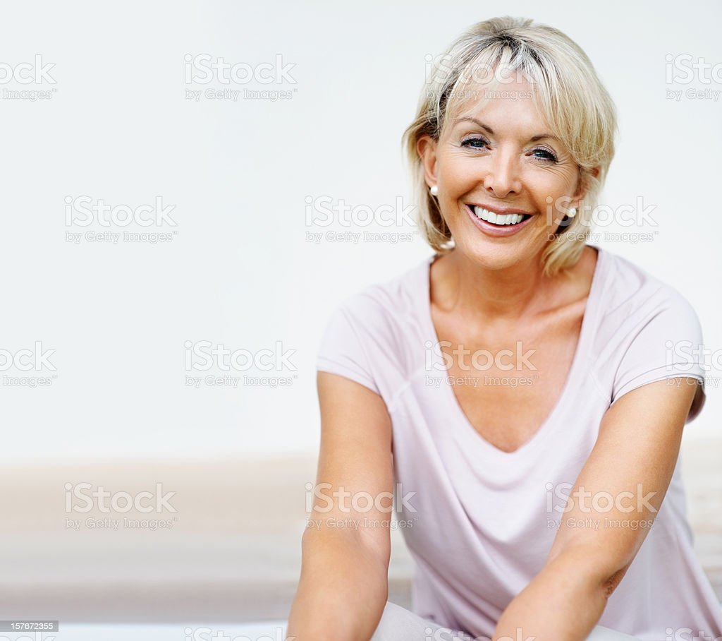 Mature woman smiling against background - copyspace stock photo