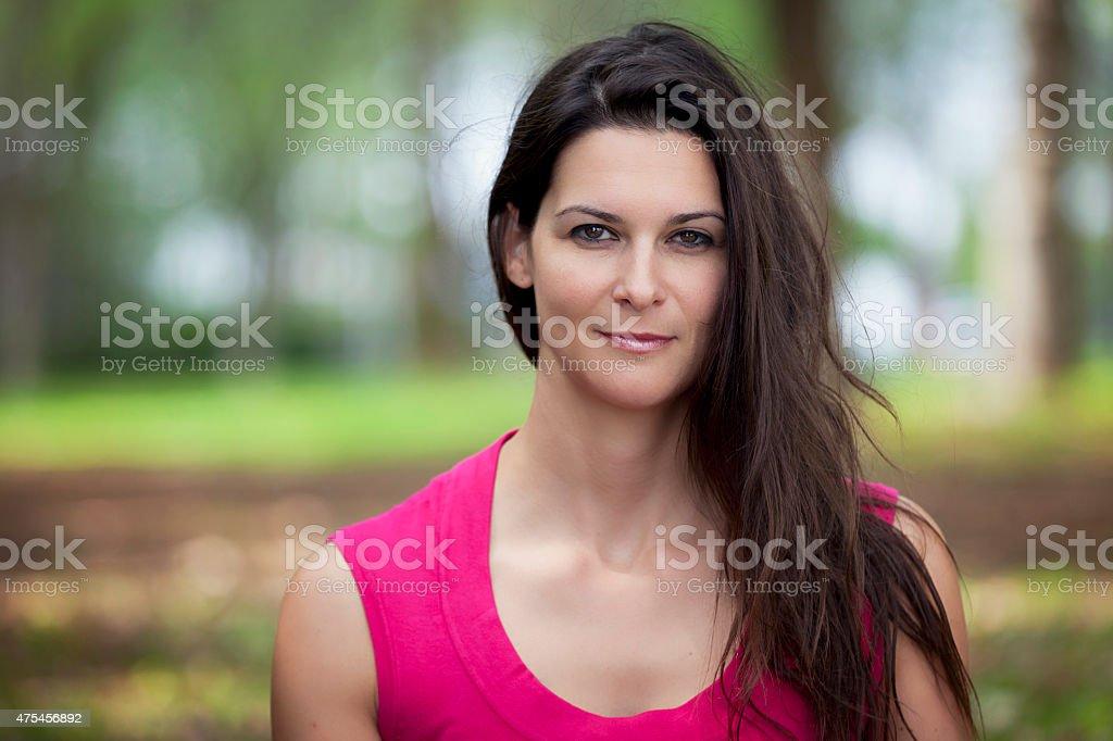 Mature Woman Smiling At The Camera stock photo