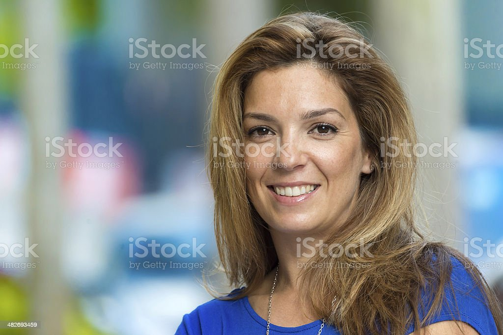 A mature woman smiling for the camera. royalty-free stock photo